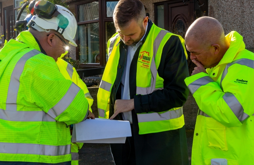 Andrew Stephenson MP being shown plans of the improvements